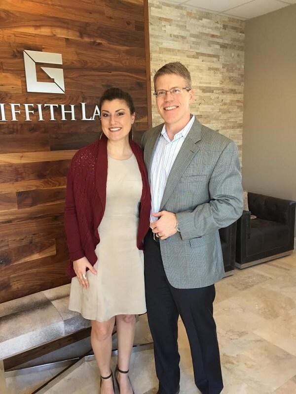 John standing with Samantha, a client