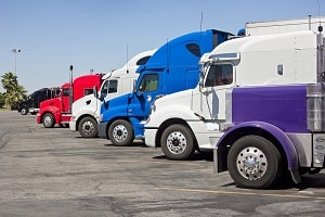 Row of semi trucks in a parking lot