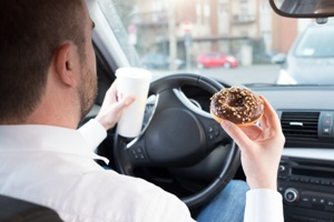dangerous and distracted driver eating while driving in Tennessee