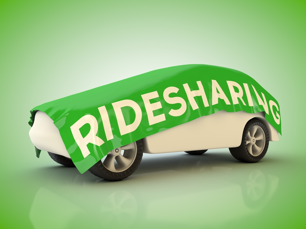 Car with Rideshare banner over it