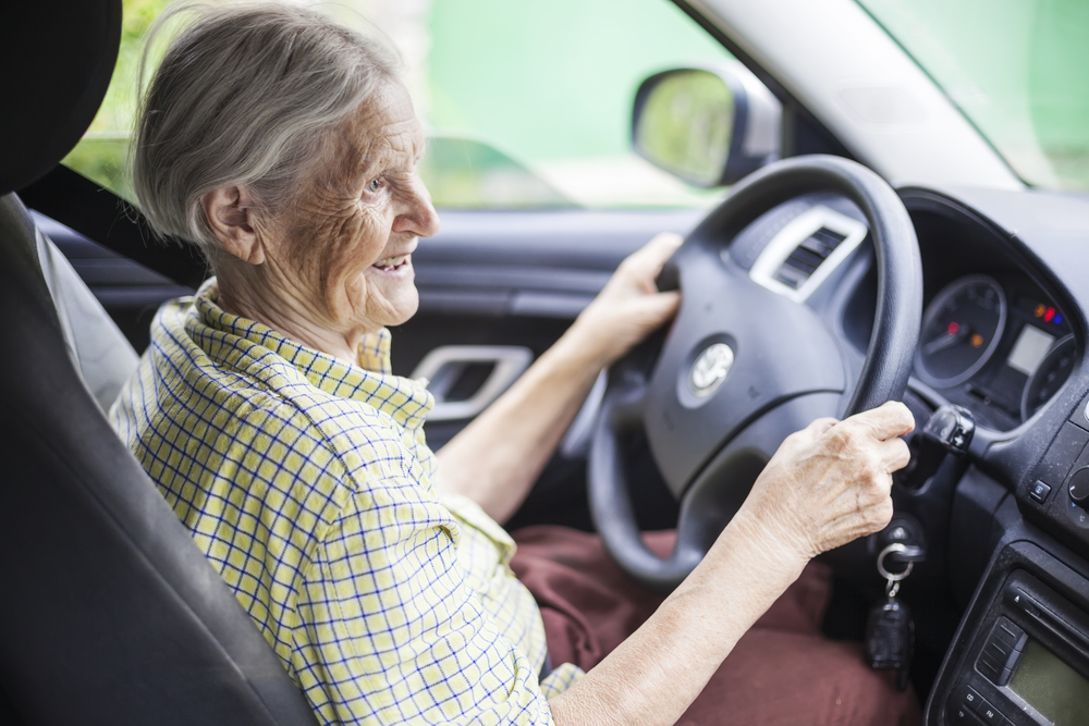Older woman driving a car