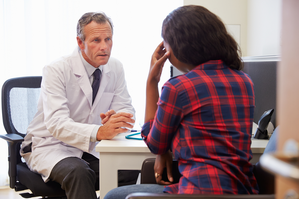 Doctor talking to patient at a desk