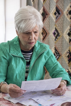 Concerned woman trying to understand car accident medical bills