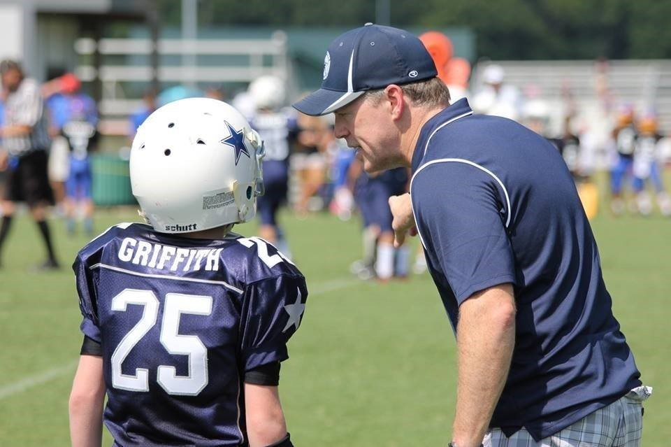 Attorney John Griffith coaching his sons football team
