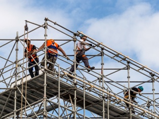 New York City construction workers on scaffolding