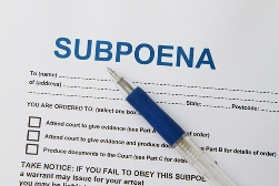 Subpoena Paperwork With a Blue Pen