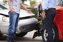 Two Men Standing in Front of a Rear-End Collision