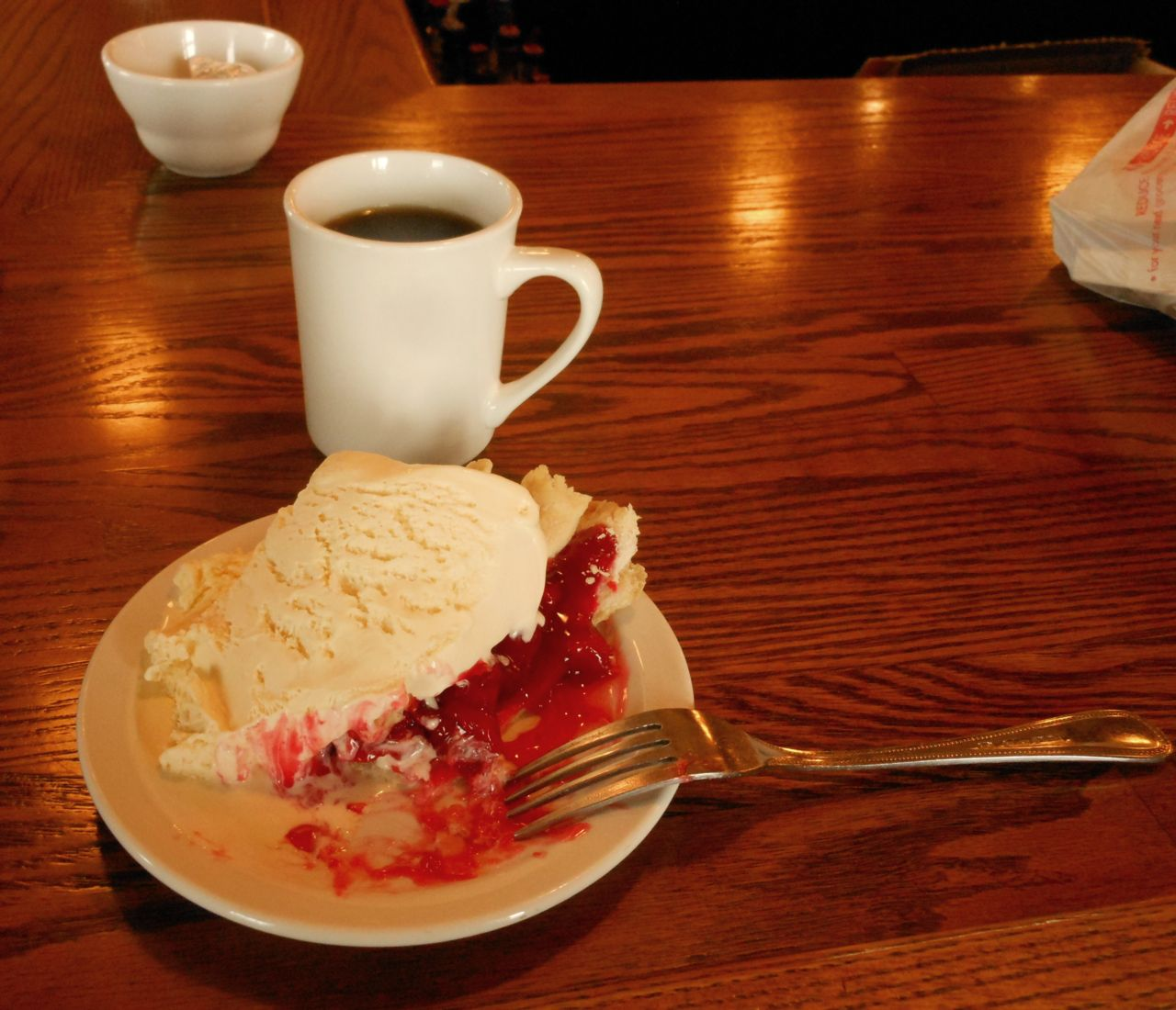 Pie and ice cream with a cup of coffee at fundraiser event