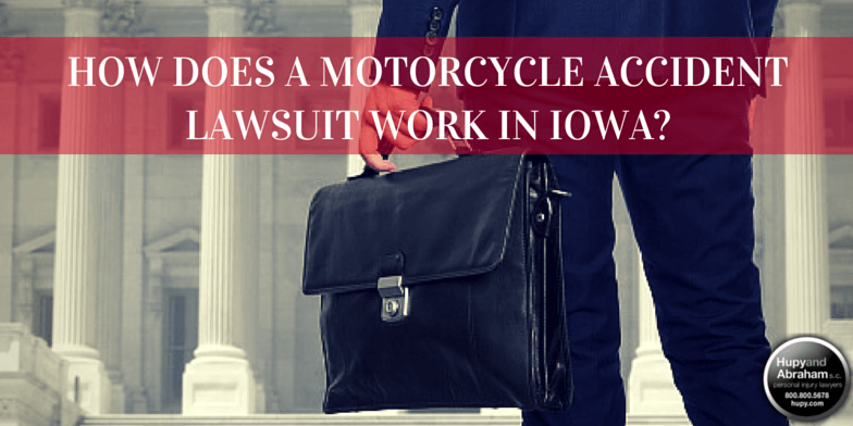 Briefcase by building with text How does a motorcycle accident lawsuit work in Iowa