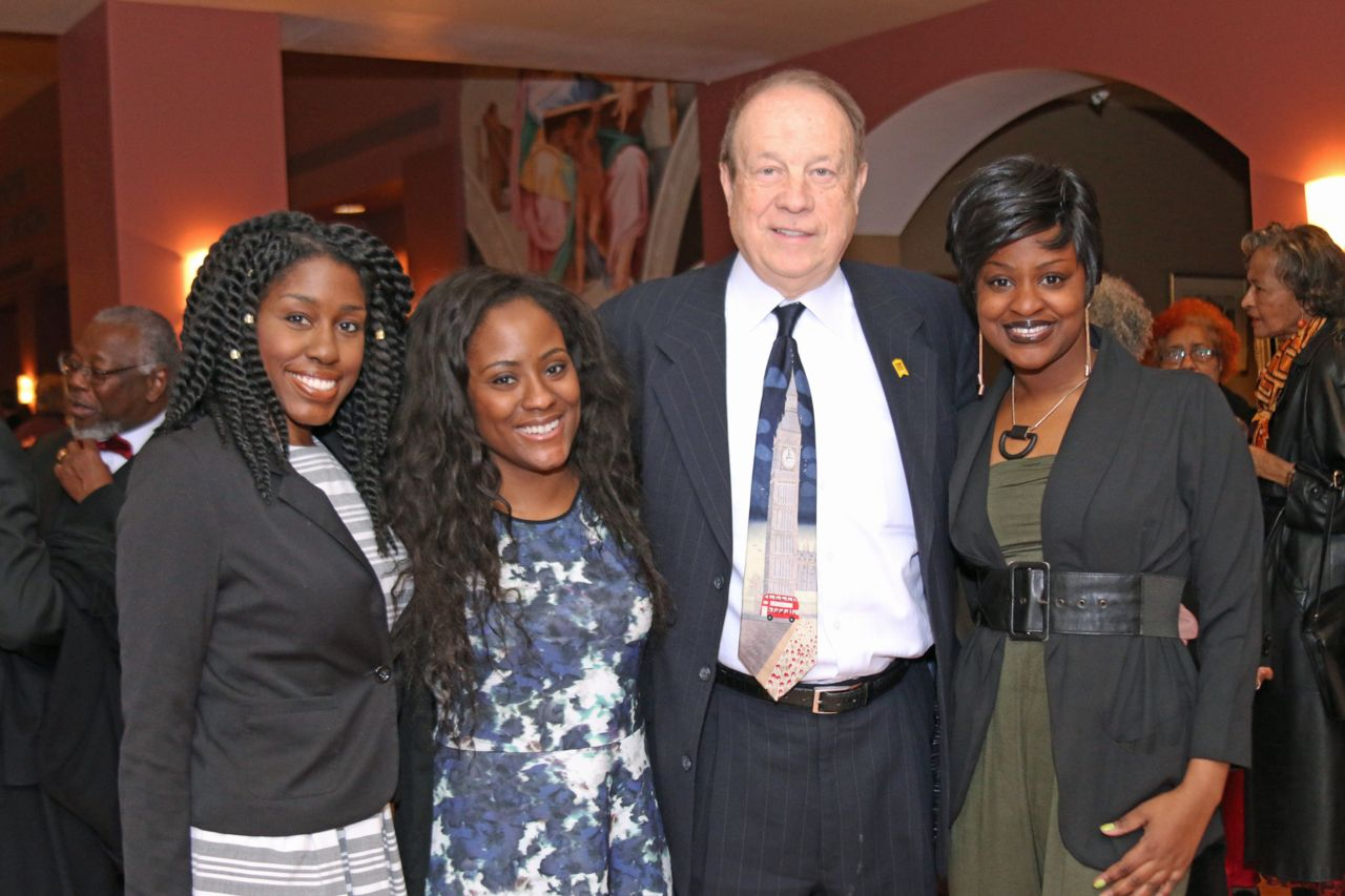 Attorney Michael Hupy with three women celebrating Black Excellence