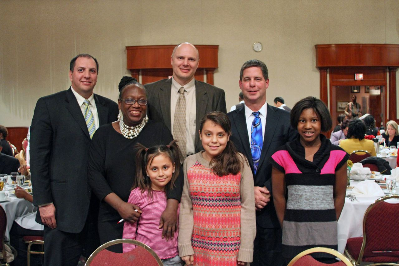 Attorney Todd Korb, Tom Perlbeg and Tim Schelwat with kids at Harvest of Hope
