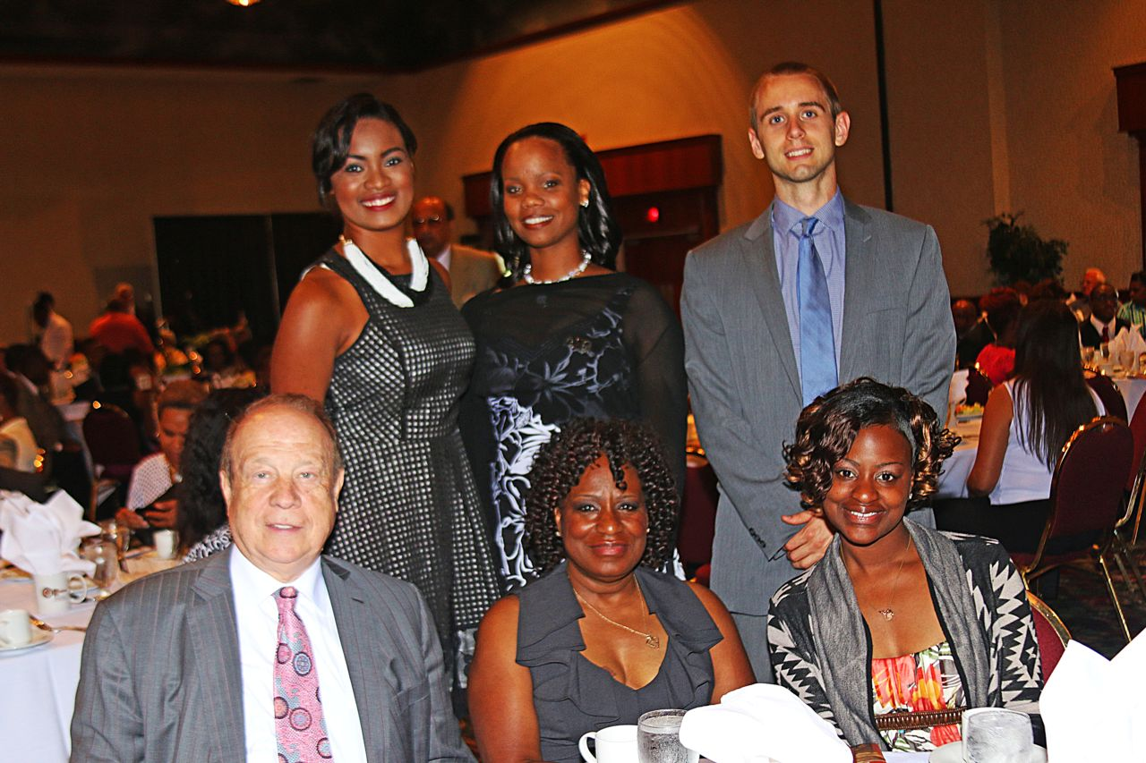 Attorney Michael Hupy and firm employees at Community Journal brunch