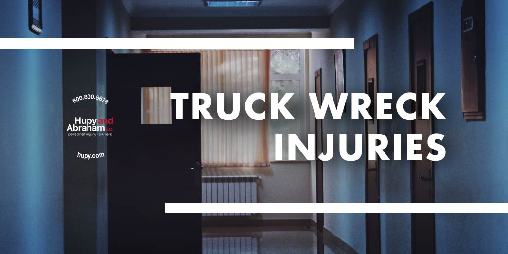 office corridor with a door open with text Truch wreck injuries