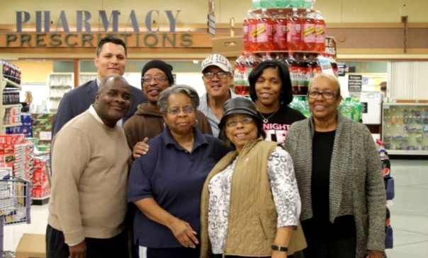 Hupy and Abraham team with Thanksgiving charity founders and helpers