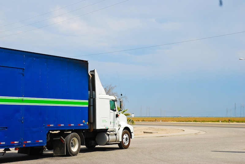 Truck driving on a empty rode with clear skies, fatigued driver