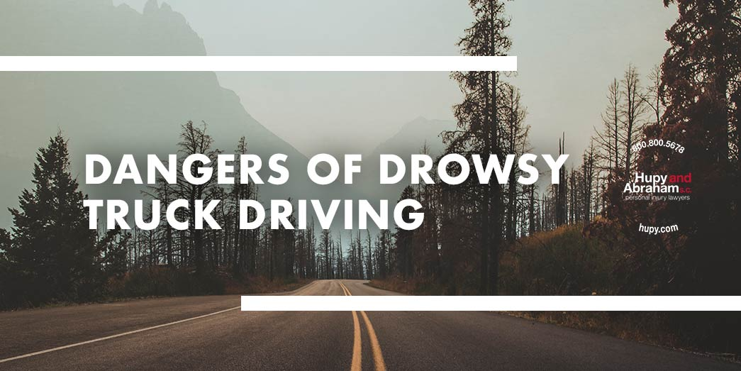 the road with trees on the side with text Dangers of drowsy truck driving