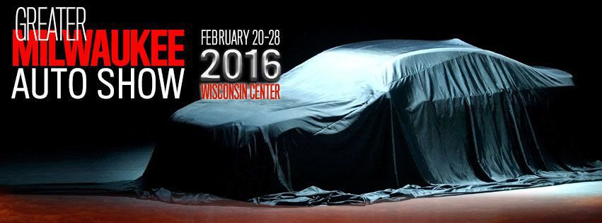 Benner of Greater Milwaukee Auto Show with car covered up with a car cover with date