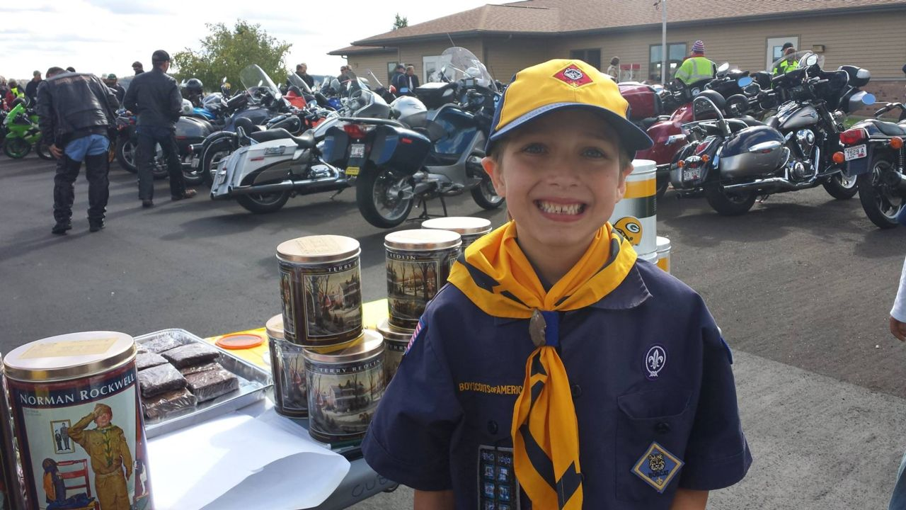 Boy scout Cole Vandervest at Pinewood Derbby with raffles