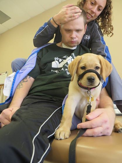 Man and women with a golden retriever, donated to man for life