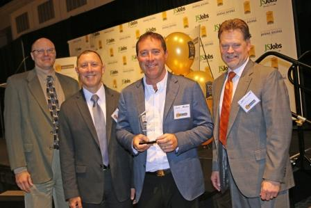 Attorney Jason Abraham with award for Top Workplace for 4th Consectuve Year