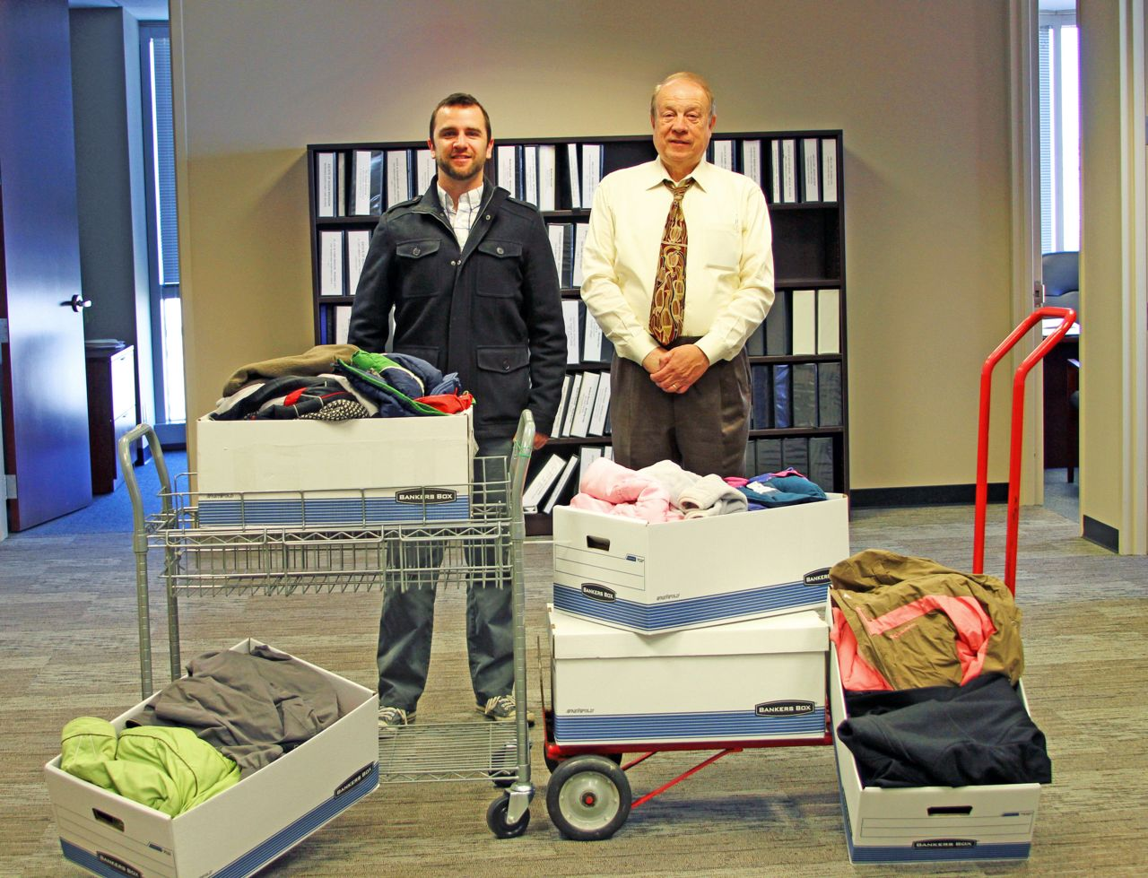 Attorney Michael Hupy and employee with boxes of clothes to share with the community
