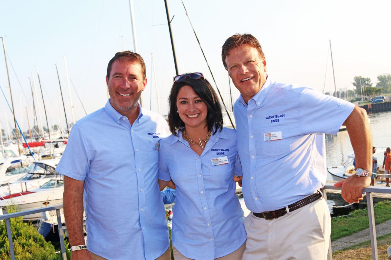 Attorney Jason Abraham with employees attending Yacht Blast event