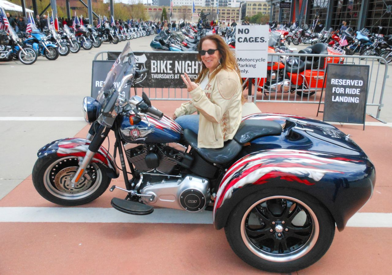 woman sitting on a bike at Troops Ride