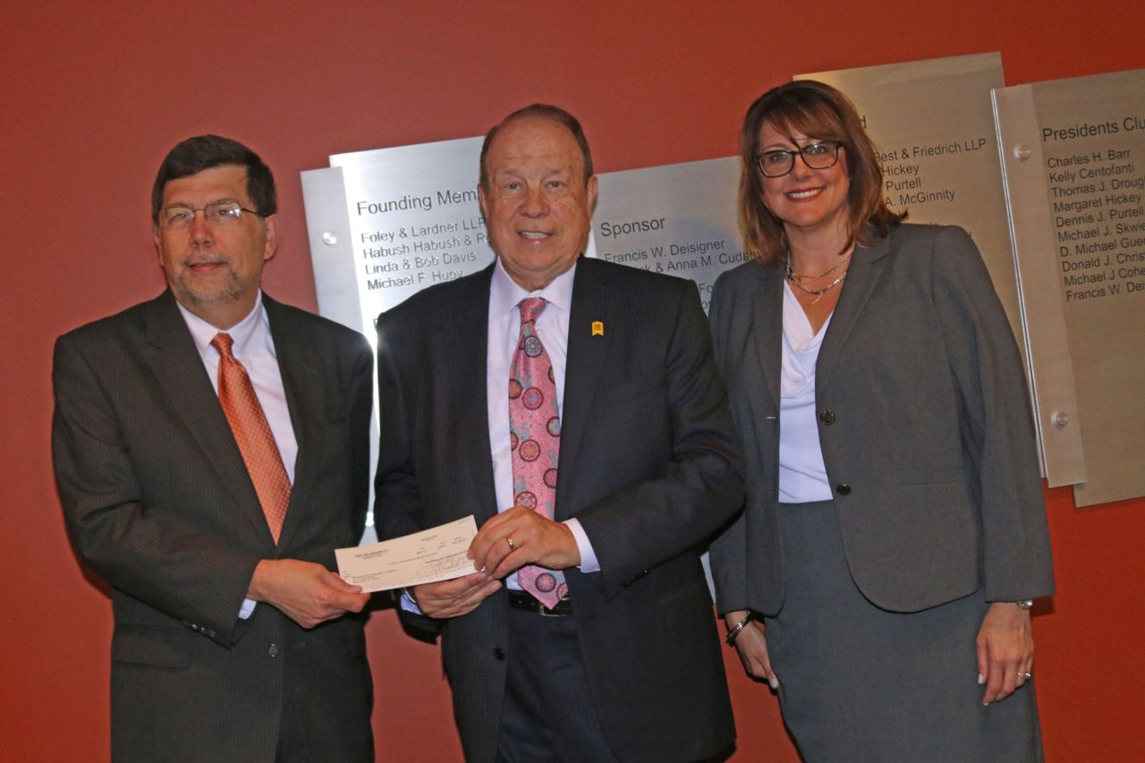 Attorney Michael Hupy donating check to Milwaukee Justice Center
