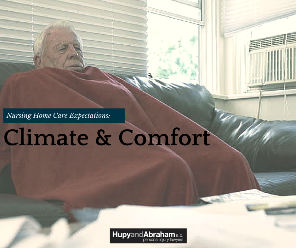 Uncomfortable nursing home resident covered in blankets trying to stay warm