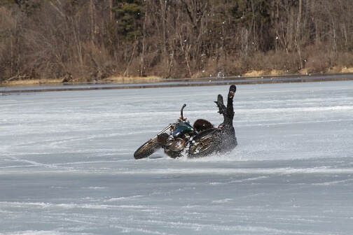 Motorcycle wreck at an ice racing competition at the McKinley Marina