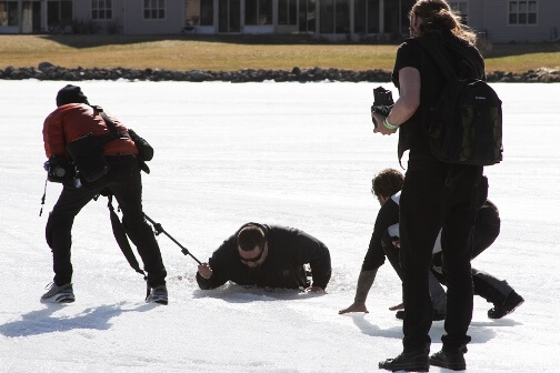 spectator falling through ice at ice racing event