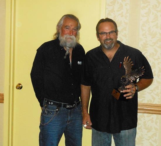ABATE of Wisconsin founder Tony Pan Sanfelipo presents the Founder's Award to Executive Director Dave Charlebois.