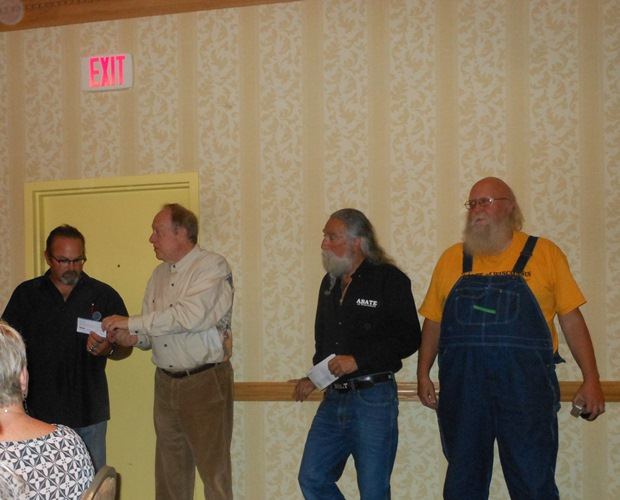 Attorney Michael Hupy presents his personal check for $5,000 to Dave Chubby Charlebois