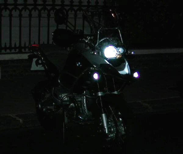 Motorcycle at night with front headlight on