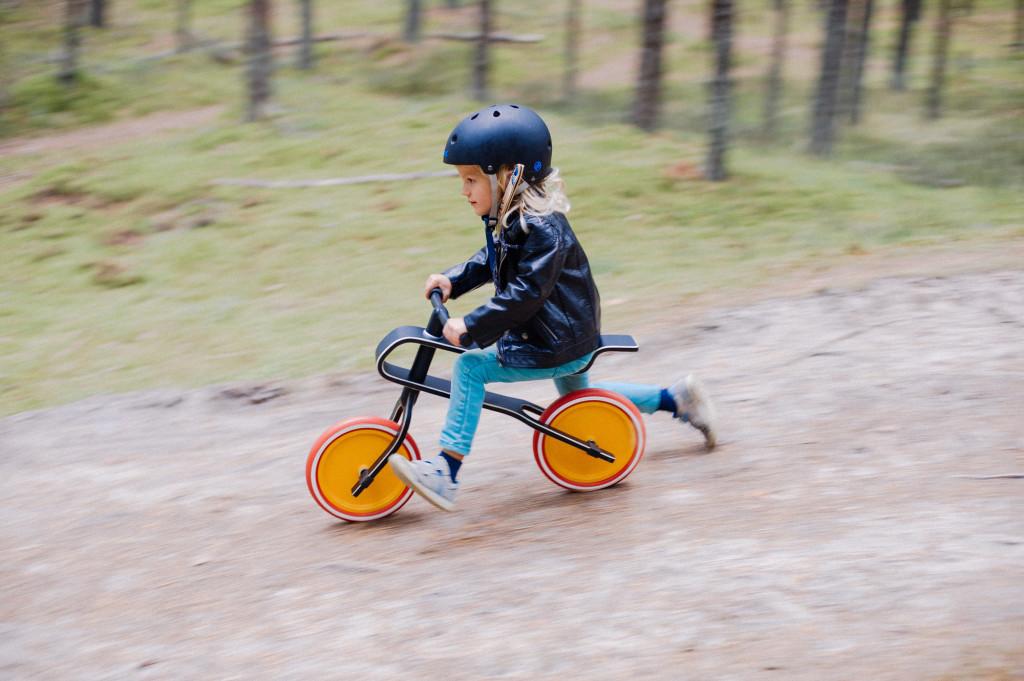 Young girl on kids bike