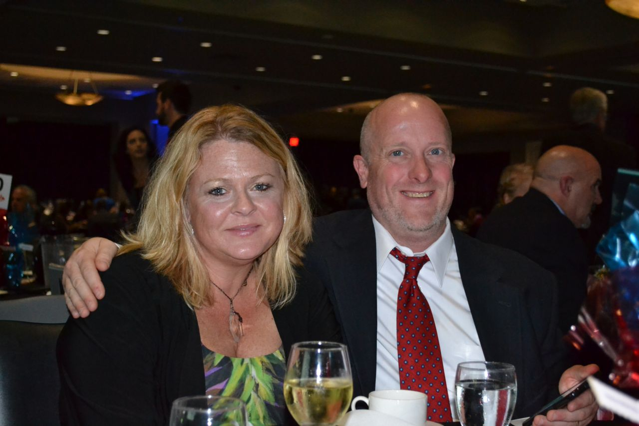 Attorney James K. Theisen and his wife at the Ties and Tennies event