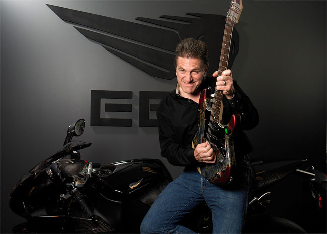Erik Buell playing electric guitar