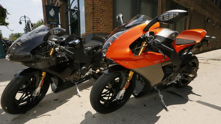 An orange and Black 2007 Buell 1125R featuring a Rotax liquid-cooled engine