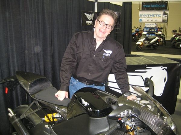 Erik Buell standing bahind a Buell motorcycle