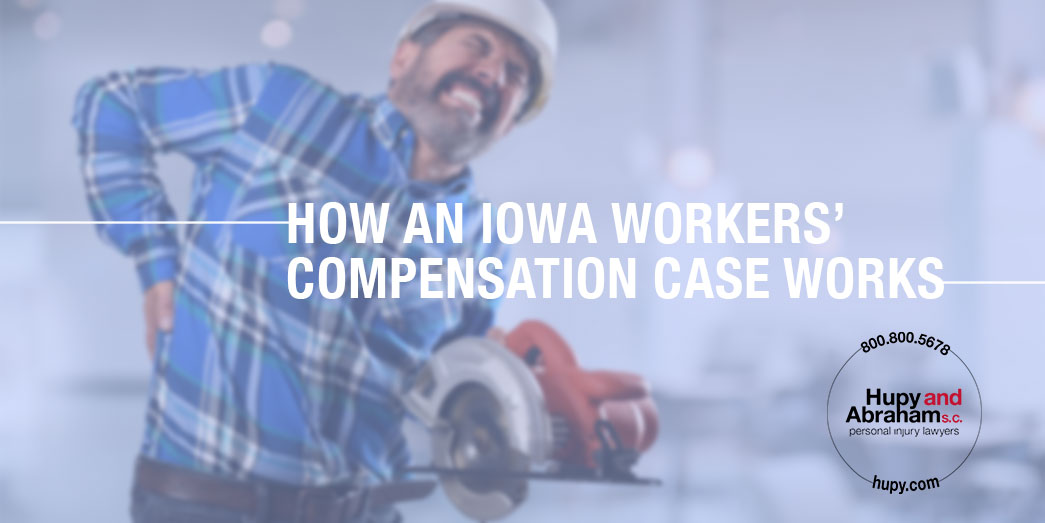An Iowa construction worker holding saw and in severe pain