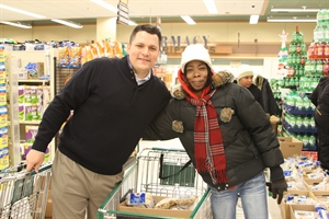 Attorney Chad Kreblin buy groceries for the community during the holiday season