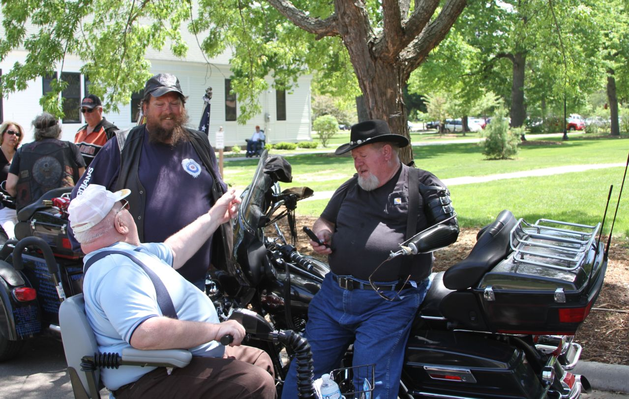 Motorcyclists engaged conversations with each other