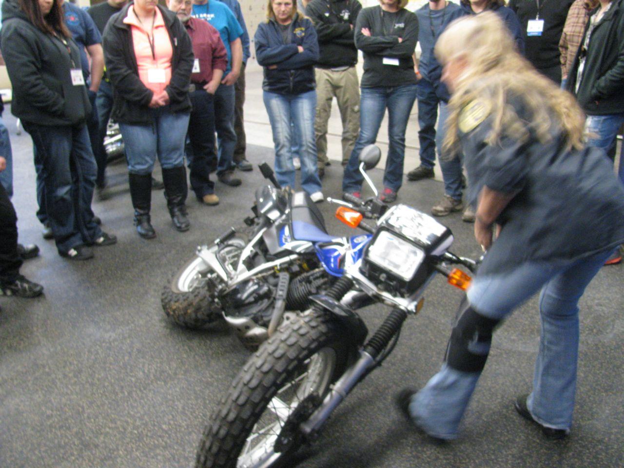 Accident Scene Management huddled around bike
