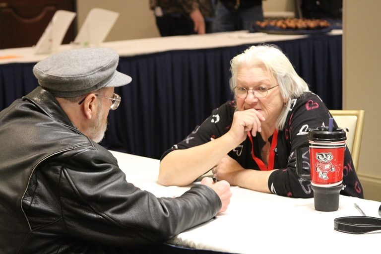 Two attendees having a conversation during Lobby Day