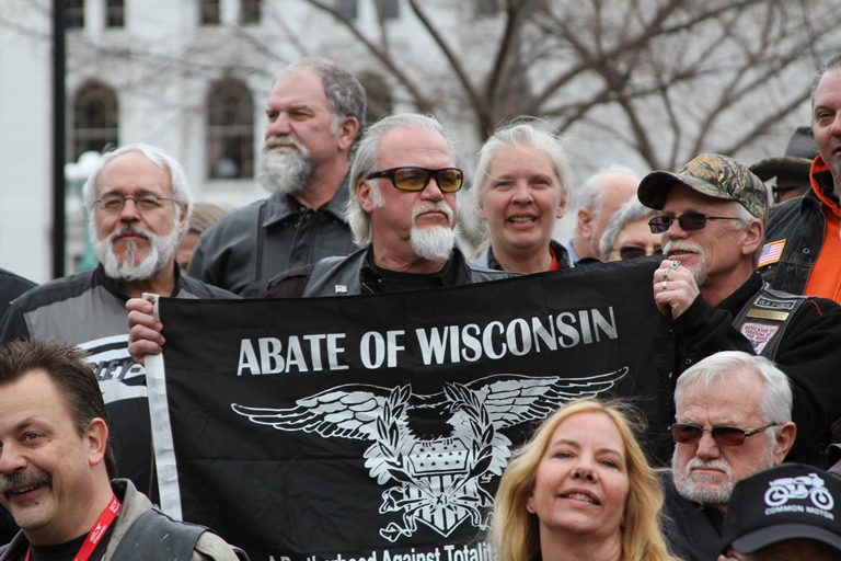 Attendees a holding a ABATE of Wisconsin flag