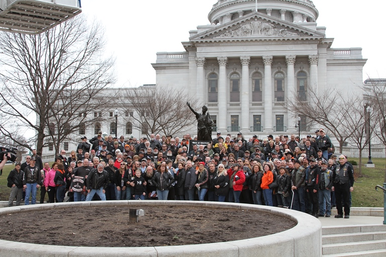 Attendees of ABATE of Wisconsin standing in front of the Capitol building