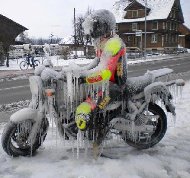 man on a motorcycle who is frozen