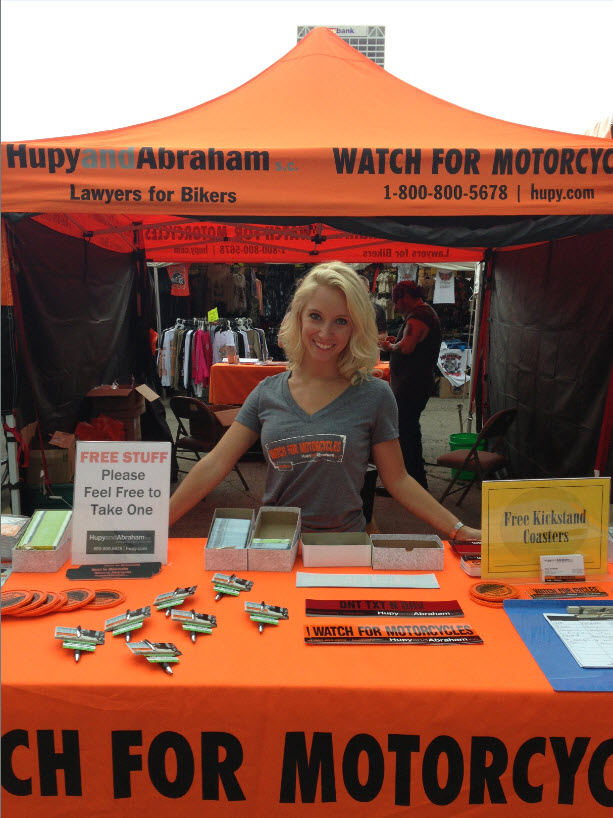Hupy and Abraham volunteers at booth