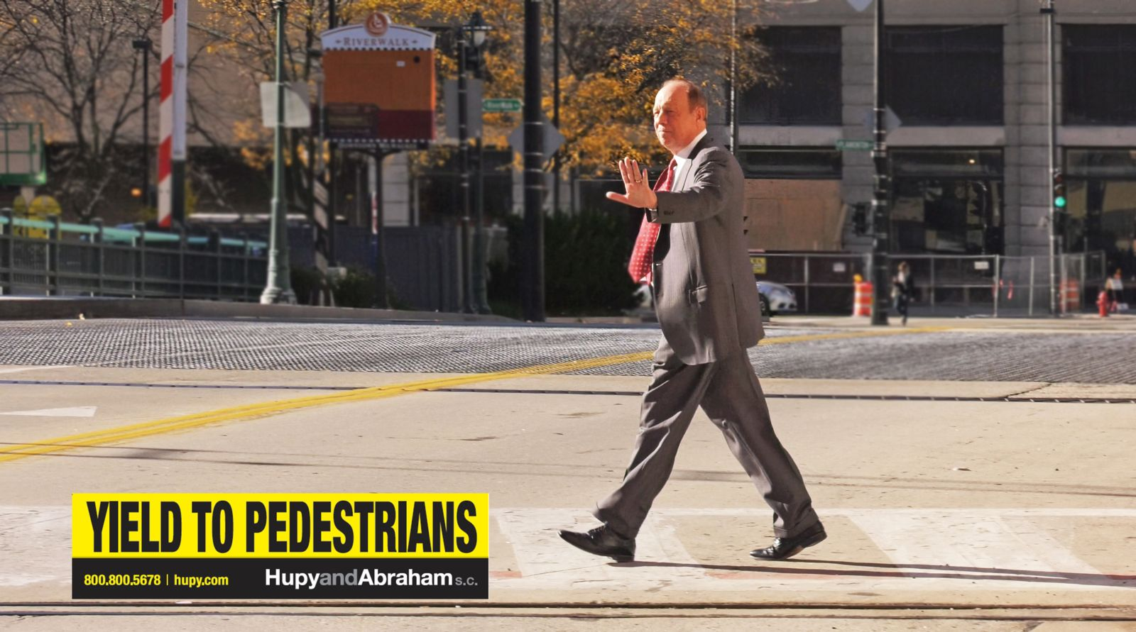 Attorney Michael Hupy crossing the street for Yeild for Pedestrians