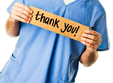 Nurse holding a thank you sign